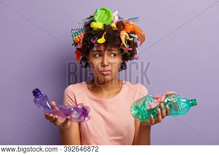 Sad Bothered Woman Holds Two Crumpled Plastic Bottles, Feels Dejected, Cleans Up Earth From Contamin