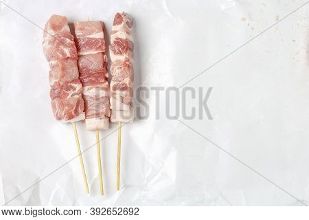 Close Up Of Three Raw Souvlaki, Top View, Meat Background