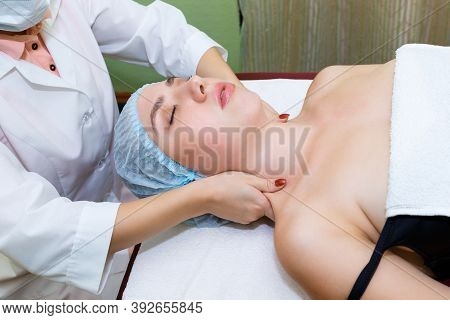 A Massage Therapist Gives A Woman A Relaxing Upper Torso Massage Before Cleansing The Skin Of The Bo