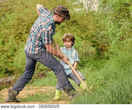 Find Treasures. Little Boy And Father With Shovel Looking For Treasures. Happy Childhood. Adventure