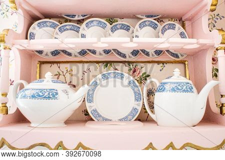 Delicate White Porcelain China Tea Set With A Selection Of Saucers, Cups And Teapots