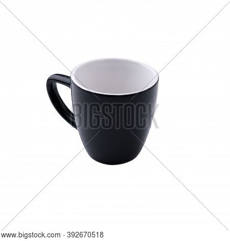 Black Small Coffee Mug With Handle, Light Inside, Isolated On A Pure White Background Without Shadow