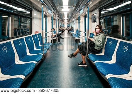Moscow. Russia. August 29, 2020 The Interior Of A Half-empty Moscow Metro Car. Passengers In Protect