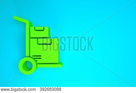 Green Hand Truck And Boxes Icon Isolated On Blue Background. Dolly Symbol. Minimalism Concept. 3d Il
