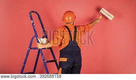 Thermal Insulation Works. Painter Man Staircase. To Make Repairs. Man In Working Clothes Painting Wa