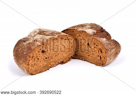 Freshly Baked Loaves Of Traditional Round Rye Bread Isolated On White Background. High Resolution Ph