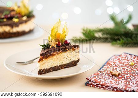 Christmas Cheesecake With Nuts On A Christmas Background.