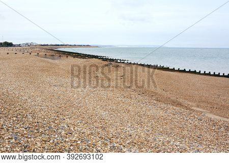 Deserted Shingle Beach In Eastbourne On The South Coast Of England. Shingle And Sand Leads Down To T