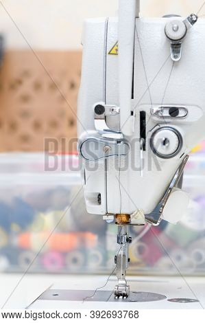 Needle Presser Foot With Thread Of Industrial Sewing Machine For Sew Cloth Copy Space Close-up.