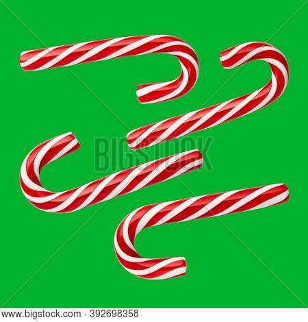Christmas candies - handmade peppermint candy canes. Set of festive sweets on a green (chromakey) background