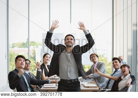 Multiethnic Business People Raising Hands Together With Excited Emotion Of Company Project Success R
