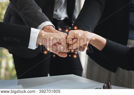 Close Up Success Business Deal With Doing Fist Bump Of Business People Hands (teamwork Or Partnershi