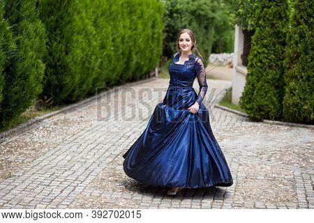 Beautiful Girl In Glamorous Ultramarine Dress. Ready For Her Prom Night.