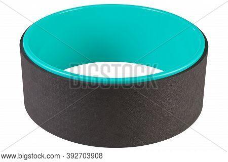 One Yoga Wheel, Turquoise And Black, Lies Horizontally, On A White Background