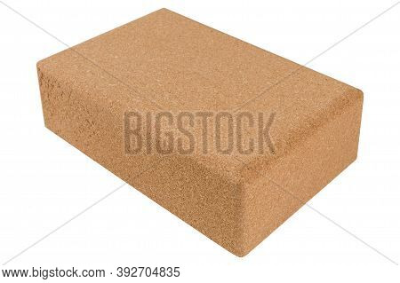 One Yoga Block Made Of Cork, Diagonal Arrangement, On A White Background, Selective Focus