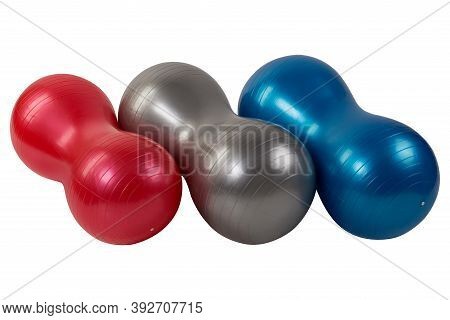 Three Fitness Balls, Red, Gray And Blue, With The Shape Of A Peanut, On A White Background