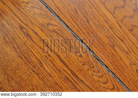 Crevice In The Wood Floor And Aged Silicone Sealant