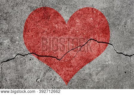 Heart Broken Painted On The Wall Background. Red Heart With A Crack. Love End Concept