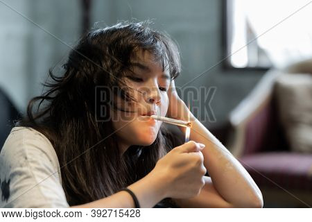 Asian Girl Smoking And Feeling Be Absent-minded