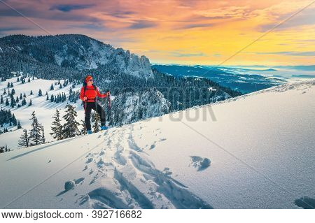 Cheerful Sporty Woman On Fresh Powder Snow, Ski Touring On The Snowy Hills. Backcountry Skier Woman