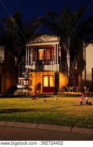 Upmarket Wealthy Suburban Neighborhood In Gated Community Estate At Night