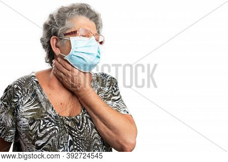 Elderly Woman Touching Neck As Throatache Sore Painful Gesture As Cold Influenza Sars Covid Symptom