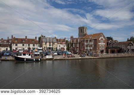 Views Of The Buildings At Wareham Quay Across The River Frome In Dorset In The Uk, Taken On The 23rd