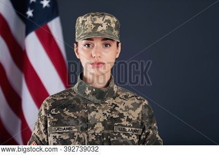 Female American Soldier And Flag Of Usa On Dark Background. Military Service