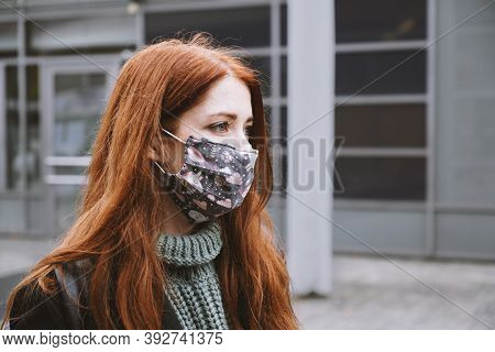 Young Woman Wearing Homemade Everyday Cloth Face Mask Outdoors In City, New Normal Covid-19 Corona V