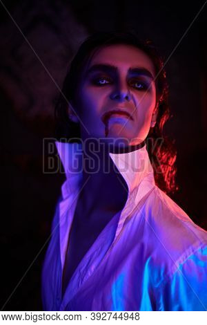 Portrait of a handsome young aristocrat vampire looking arrogantly to the camera.