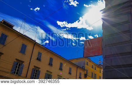 October 2020 Parma, Italy: Parma Point Board Across Cityview, Blue Sky With Clouds And Sunlights