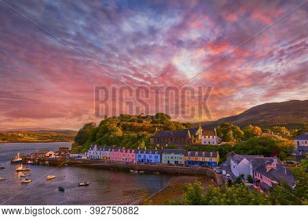 sunset over famous Quay street in Portree, Isle of Skye, Scotland