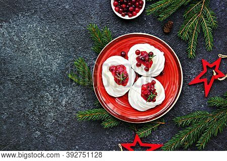 Portion Pavlova Meringue Pastries With Cream And Cranberry Sauce In New Years Or Christmas Decor On