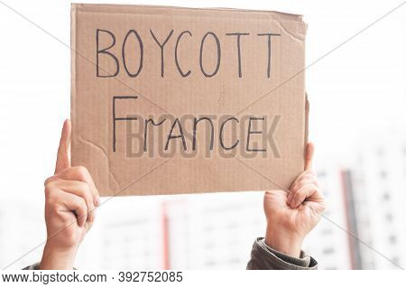 A Man Holds A Cardboard Poster With The Inscription Boycott Of France
