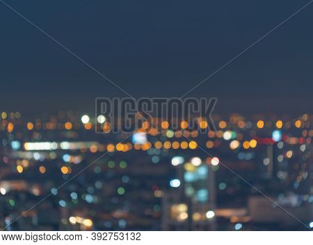 Bokeh Abstract Background Of Skyscraper Buildings In Bangkok City, Thailand With Lights, Blurry Phot