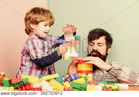 Child Development And Upbringing. Importance Of Playing Together. Dad And Son Have Fun. Childish Che