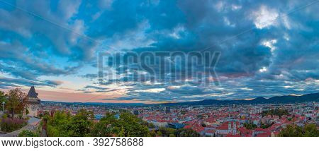 Cityscape Of Graz And The Clock Tower, Famous Tourist Attraction On Schlossberg Hill, Graz, Styria R