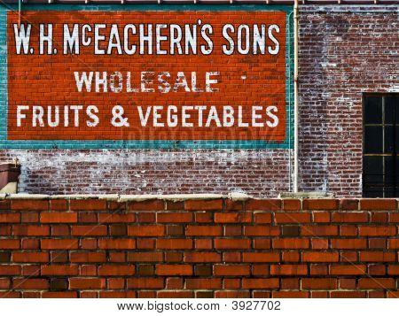 Weathered Sgin On Brick Wall