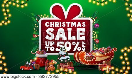 Christmas Sale, Up To 50 Off, Green Discount Banner With Large Cartoon Present With Large Offer Deco
