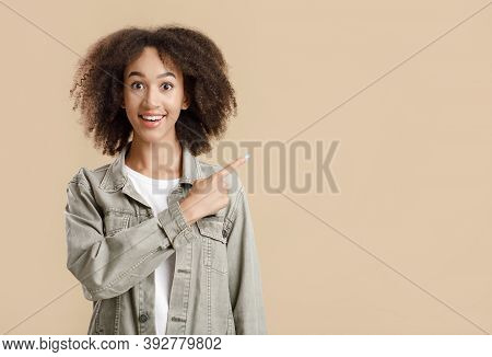 Favorable Offer And Advice For Advertising. Laughing Millennial African American Lady Looks At Camer
