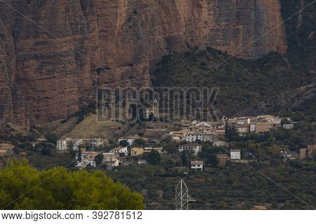 Riglos, Spain - October 15, 2020: General View Of The Town Of Riglos, At The Foot Of The Huge Walls