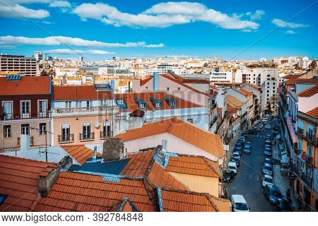 Lisbon, Portugal.- February 11, 2018: Old Town Lisbon. Street view of typical houses in Lisbon, Portugal, Europe