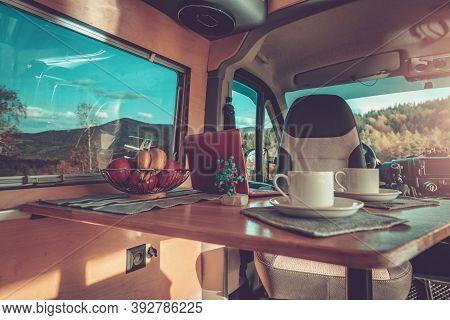 Camping Time Inside Comfortable Motorhome Interior. Stylish Self Made Camper Van Interior. Van Conve