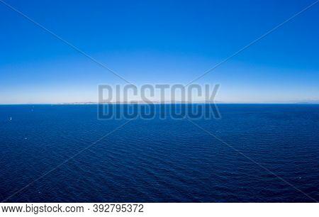 Kea, Tzia Island, Destination Greece. Blue Sky Over The Sea Background