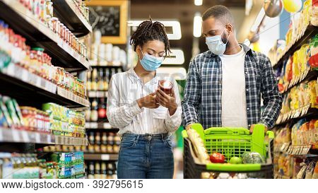 African Family Couple In Shop Buying Groceries Wearing Face Mask Choosing Food Goods Walking With Sh