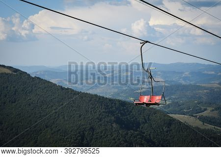 Empty Chairlift On A Background Of Beautiful Autumn Mountains