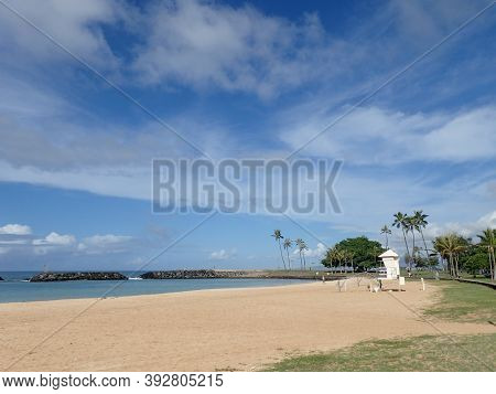 Beach And Lifeguard Stand On Magic Island In Ala Moana Beach Park On The Island Of Oahu, Hawaii.  On