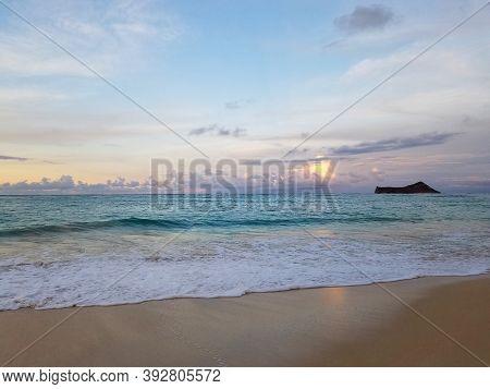 Gentle Wave Lap On Waimanalo Beach Looking Towards Manana (rabbit) Island At Dusk Oahu, Hawaii.