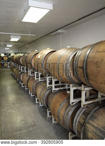 Treasure Island, California - October 8, 2011: Rows Of Wooden Barrels Inside Wine Barrel Room At Win