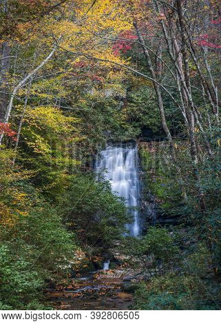 Serene Waterfall Captured During Autumn In Tennessee
